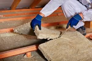 loft insulation. laying loft insulation