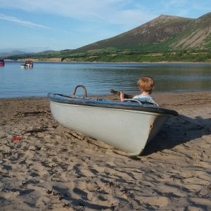 Toddler in a boat on a beach